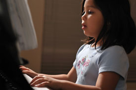 Student taking piano lessons in Roswell, Georgia